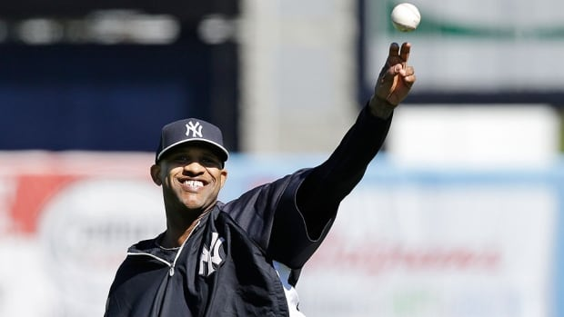 Yankees' left-handed pitcher CC Sabathia throws in the outfield during spring training baseball practice on Friday in Tampa. He reported to camp at a slimmed-down 275 pounds, 40 below his high.