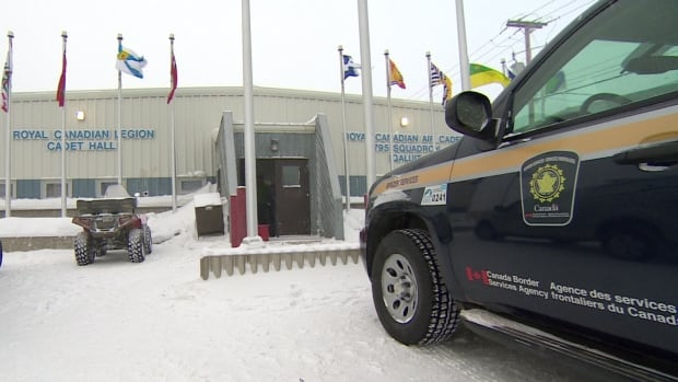 More than 200 passengers from a diverted Delta airlines flight waited at Iqaluit's cadet hall under the supervision of Canada Border Services Agency officers for another plane to arrive to take them to their destination of Seattle.