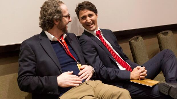 Justin Trudeau chats with his chief adviser, Gerald Butts, who is at the head of an inner circle that will manage the 2015 election campaign.