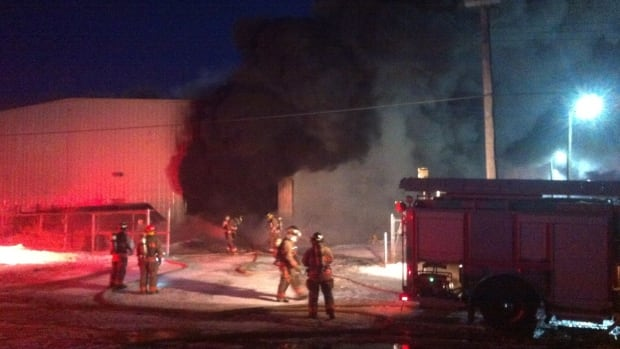 Firefighters work to extinguish a two-alarm fire at a Sutherland warehouse.