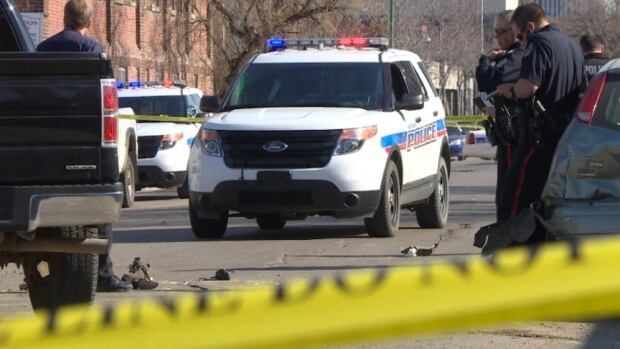 Regina police attend the scene of a hit-and-run on the 1800 block of Angus Street that put an officer in hospital.