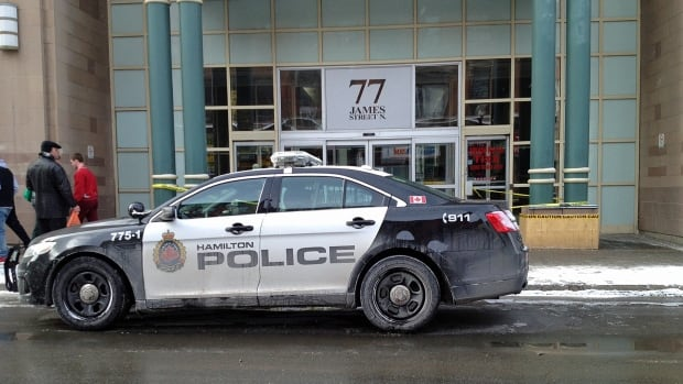 Police cruisers were parked outside the mall on Sunday as the standoff continued inside.
