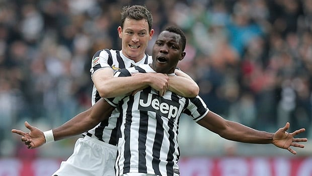 Juventus' Kwadwo Asamoah, right, celebrates with teammate Stephan Lichtsteiner after scoring against Chievo at Juventus Stadium in Turin on February 16, 2014.