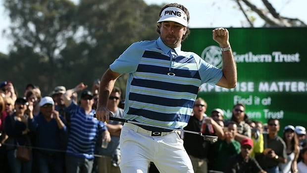 Bubba Watson celebrates a birdie on the 18th green to win the final round of the Northern Trust Open at the Riviera Country Club on February 16, 2014 in Pacific Palisades, California.