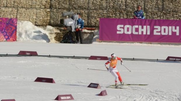 Yukon skier Emily Nishikawa rounds a corner during the women's 4x5 km cross-country ski relay in Sochi, Russia on Saturday.