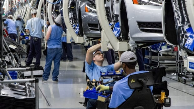 Workers assemble Volkswagen Passat sedans at the German automaker's plant in Chattanooga, Tenn. Workers rejected the United Auto Workers union in a narrow vote on Friday.