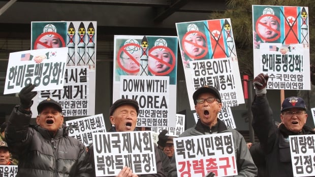 Feb. 16: Protesters shout anti-North Korea slogans with placards of defaced images of North Korean leader Kim Jong Un and the late leader Kim Jong Il in the background during a rally in Seoul, South Korea.