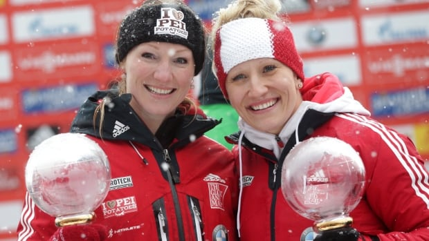Vancouver Olympic gold medalists Kaillie Humphries, right, and Heather Moyse pose with the trophy after the two-woman bobsled World Cup race in Germany in January.