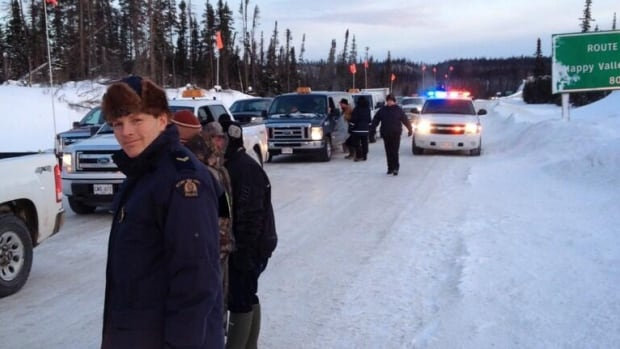 RCMP officers escorted vehicles at a demonstration on the Trans-Labrador Highway near the Muskrat Falls construction site.