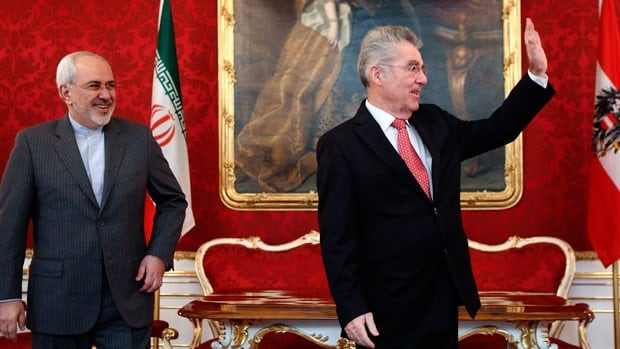 Austrian President Heinz Fischer, right, waves as he receives Iranian Foreign Minister Mohammad Javad Zarif in his office in Vienna on Tuesday. Six world powers and Iran began talks in Vienna today in pursuit of a final settlement on Tehran's disputed nuclear programme in the coming months.