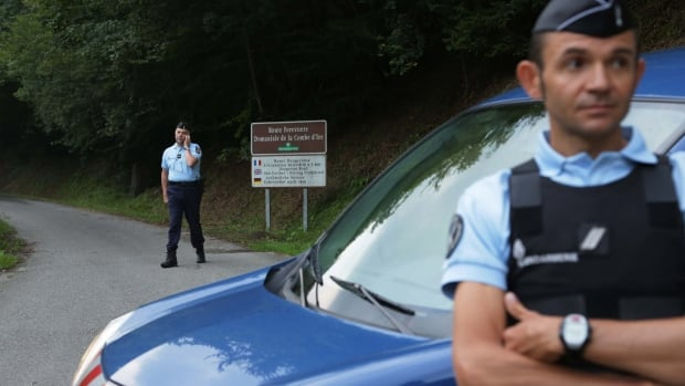 French authorities have detained a 48-year-old Frenchman in the grisly shooting death of a British-Iraqi man and three others in the French Alps almost 18 months ago. Here, gendarmes block access to a killing site near Chevaline on Sept. 5, 2012.