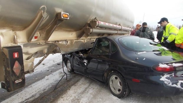 A car is shown half-crushed after it collided with an oil tanker truck Monday in Happy Valley-Goose Bay. The driver of the car was not seriously injured.