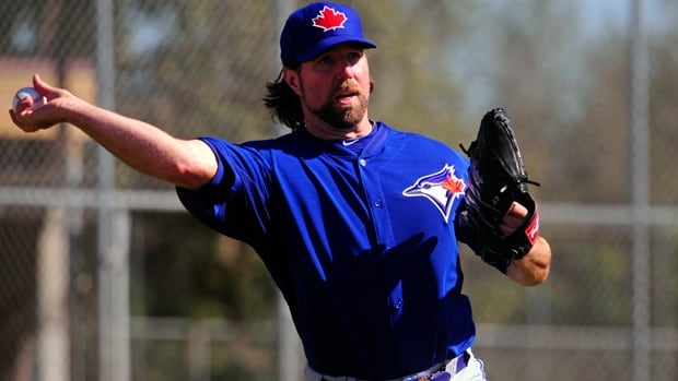 Toronto Blue Jays knuckleball pitcher R.A. Dickey warms up at the Bobby Mattick Training Center in Dunedin, Fla., on Tuesday.