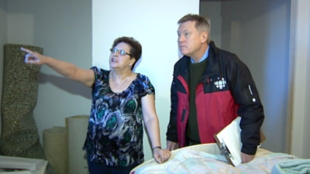 Vicky Middleton shows the CBC's Mark Harvey the unfinished work in her basement suite.