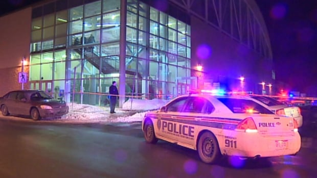 Royal Newfoundland Constabulary officers searched for evidence outside the Field House on Memorial University's St. John's campus.