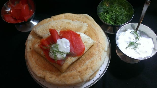 Blini are traditionally served with butter, caviar and sour cream, but they can be filled with any number of your favourite sweet or savoury fillings.