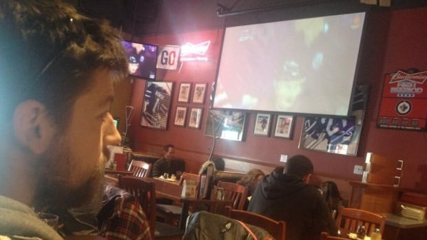 David Livingstone watches the Olympic men's hockey quarter-final from a Boston Pizza restaurant on Pembina Highway on Wednesday.