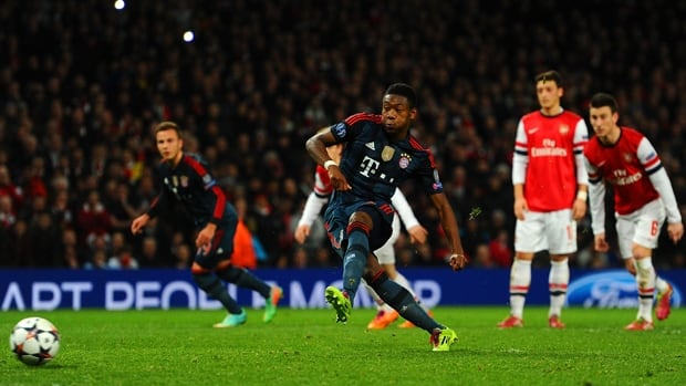 David Alaba, middle, of Bayern Munich misses on a penalty kick in Wednesday's 2-0 victory over Arsenal at Emirates Stadium.