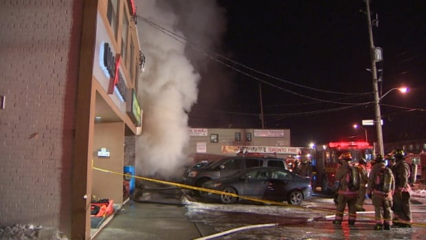 Fire crews battle a four-alarm blaze at a Rexdale fabric store.