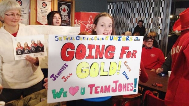 The St. Vital Curling Club in Winnipeg is packed with fans cheering on Team Canada's Jennifer Jones, going for gold in the Olympic women's curling final in Sochi. Jones home rink is the St. Vital club.