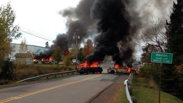 RCMP vehicles burning in Rexton
