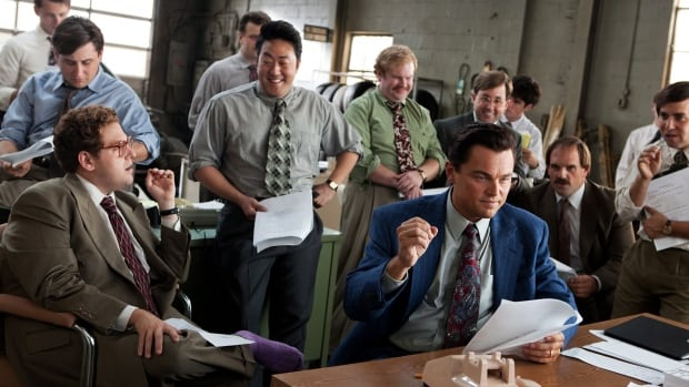 The Wolf of Wall Street cast members (from left) Jonah Hill, Kenneth Choi, Henry Zebrowski, Leonardo DiCaprio, P.J. Bryne and Ethan Suplee appear in a scene from the Oscar-nominated film. A lawyer has filed suit against the filmmakers for allegedly modelling Bryne's character after him.