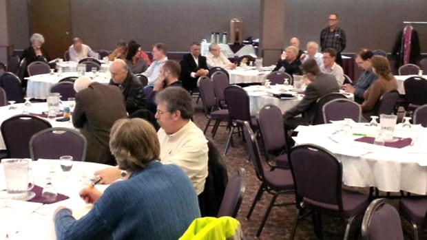 Dozens of people gathered Wednesday night for one of 18 planned forums at a hotel in downtown Calgary.