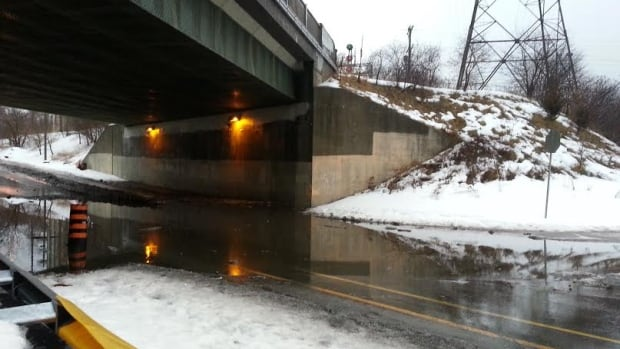 Water flooded the underpass where the Canadian Pacific Railway line over Royal York Drive at Dundas Street West.