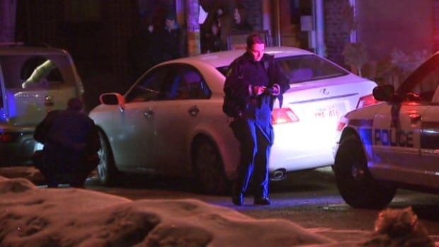 Police investigate the scene of a carjacking in south Edmonton Thursday night.