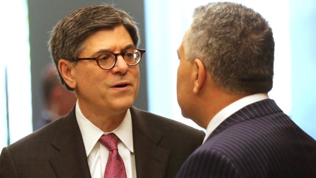 U.S. Secretary of the Treasurer Jacob Lew, left, speaks with Australia's Treasurer Joe Hockey after a press conference  in Sydney, Australia, on Friday.