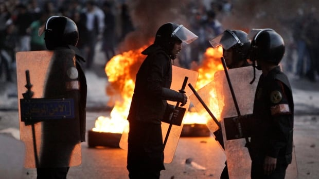 Egyptian riot police filled the streets in early 2011 amid wide-spread anti-government demonstrations. Prosecutors alleged that, in Alexandria, commanders armed police with live ammunition and allowed officers to shoot at protesters in front of police stations from nearby rooftops.