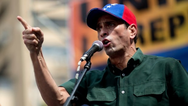 Opposition leader Enrique Capriles delivers a speech next to Lilian Tintori during a rally in Caracas, Venezuela, on Saturday.