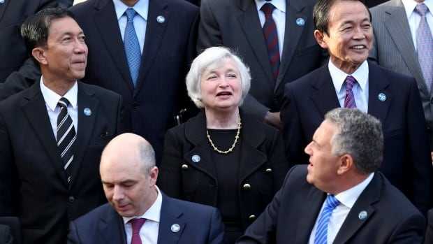 Australian Treasurer Joe Hockey, front right, looks back to U.S. Federal Reserve Chair Janet Yellen centre, while delegates pose for an official photo at the Opera House in Sydney.