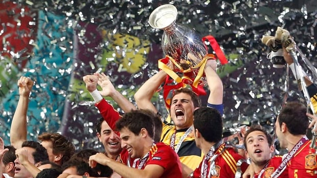On Sunday, two-time defending European champion Spain drew a seemingly comfortable road for Euro 2016 after being slotted in a group with  Luxembourg, Macedonia, Belarus, Slovakia and Ukraine. Pictured above, goalkeeper Iker Casillas, middle, lifts the trophy after the Euro 2012 soccer championship final against Italy.