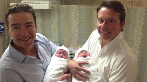 Maxime St-Pierre and Liberal MP Scott Brison hold their new daughters.