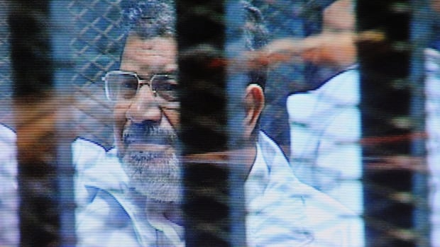 Mohammed Morsi spends his days in court in a soundproof, barred glass cage. The ousted Egyptian president and 35 others are facing charges of conspiring with foreign groups and undermining national security.