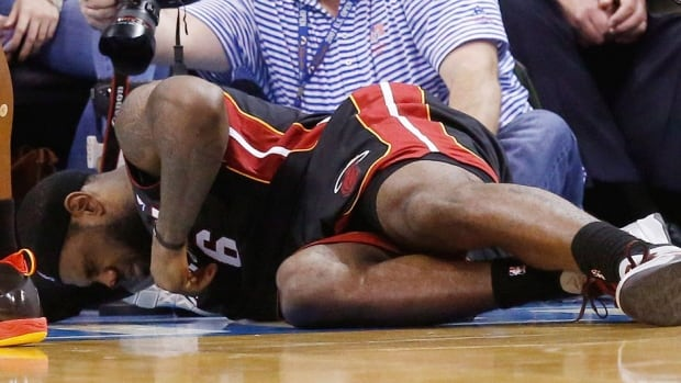 Heat forward LeBron James grimaces as he lies on the floor with a bloody nose in the fourth quarter of Thursday's game against Oklahoma City. He will miss Sunday's contest against Chicago and is questionable for Thursday's visit to New York versus the Knicks.