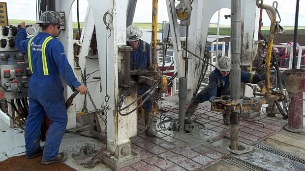 Roughnecks work at a gas facility in the Bakken oil field.