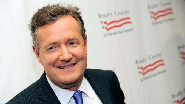 Piers Morgan, seen here at an event last year in Beverly Hills, Calif., will be ending his hosting duties at CNN's primetime show Piers Morgan Live after a three-year run.  (Chris Pizzello/Invision/Associated Press)