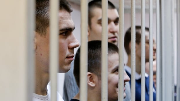 Seven defendants were sentenced to prison terms up to four years long on Monday after a Russian court convicted them of rioting and attacking police at a protest.