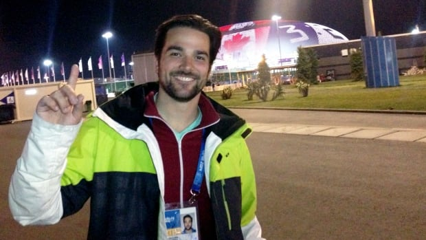 Me outside of the outside of the Bolshoy Ice Dome after Canada's women won gold in hockey.