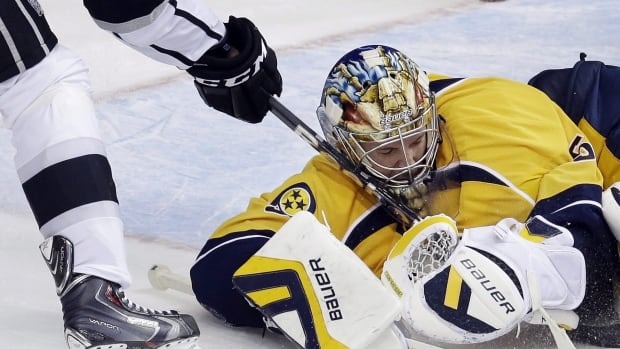 Nashville Predators goalie Pekka Rinne is shown blocking a shot in one of the last games he played before being shut down with a hip injury.
