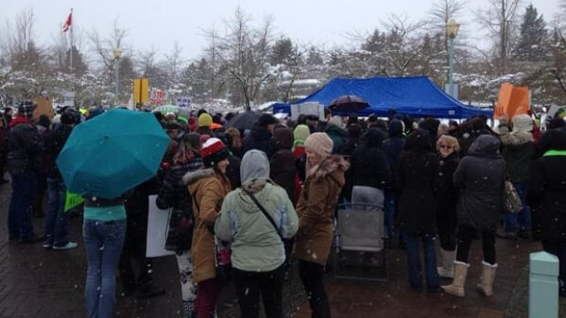 Hundreds of people gathered in the snow outside Abbotsford City Hall Monday to protest the city's handling of homelessness.