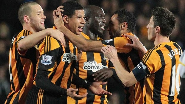 Hull City's English defender Curtis Davies, second left, celebrates after scoring his team's first goal against Brighton on Monday.