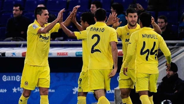 Villareal forward Jeremy Louis Perbet, left, is congratulated by his teammates after scoring on Monday.