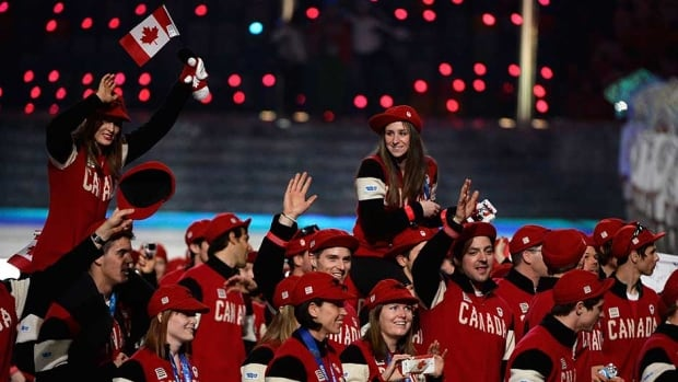 Team Canada athletes enter during the 2014 Sochi Winter Olympics Closing Ceremony at Fisht Olympic Stadium on Sunday in Sochi.