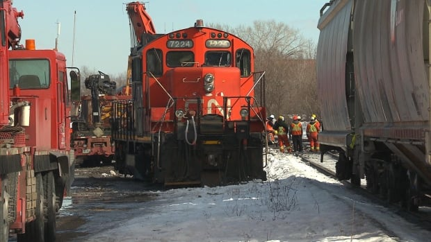 CN crews continue their clean-up operation Monday, after a train derailment in St-Henri spills 3,500 litres of diesel fuel.