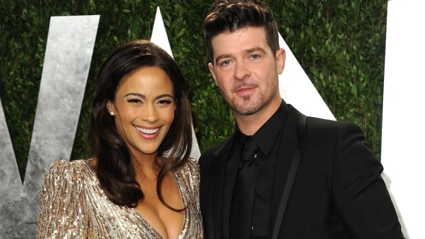 Paula Patton and Robin Thicke, seen in West Hollywood in Feb. 2013, are ending their nine-year-old marriage.