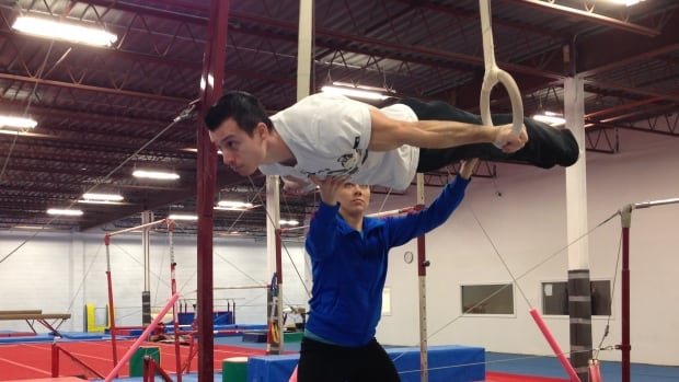 A Romanian gymnast who moved to Windsor, Ont., four years ago wants to compete for Canada at the 2016 Olympics but he may not be a citizen in time.