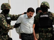 """Joaquin """"El Chapo"""" Guzman is escorted by soldiers in Mexico City, January 8, 2016."""
